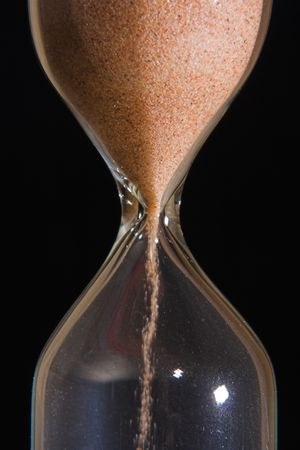 endlessness: Sand-glass with flowing sand took close