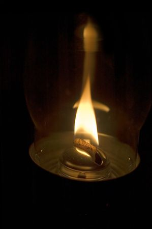 wicks: series: isolated on black: fire in the oil lamp