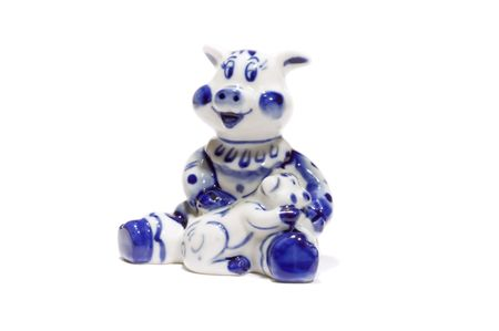 young pig: series: isolated on white: toy - ceramics young pig Stock Photo