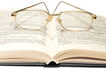 series object on white: isolated -Book with glasses