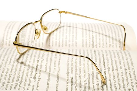 series object on white: isolated -Book with glasses photo