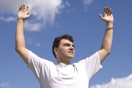 atmospheric: man on blue sky. hand up Stock Photo
