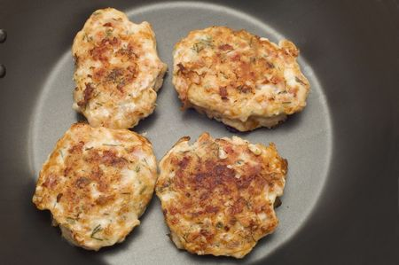 series object on white food - chiken fritters photo