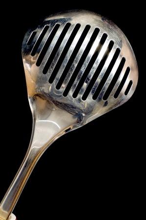 series object on black: kitchen utensil colander Stock Photo - 1367334