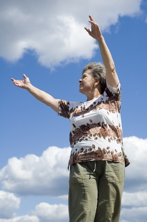 narrowly: woman with smile on blue sky and clouds