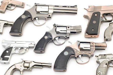 object on white tool - pistol lighter photo