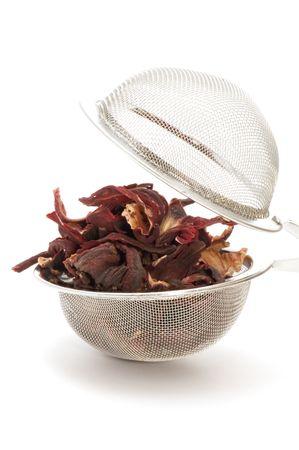 object on white - kitchen utensil tea-strainer with tea photo