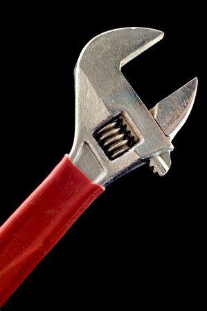 object on black - tool adjustable spanner macro photo