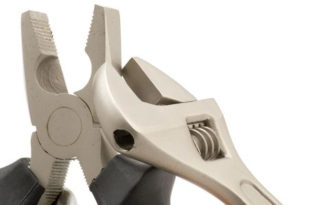 object on white - tool monkey wrench with pliers photo