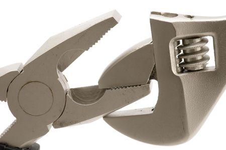 alicates: objeto en blanco - herramienta mono llave con unos alicates  Foto de archivo