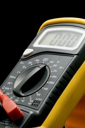 object on black - electrical measurement - Digital multimeter photo