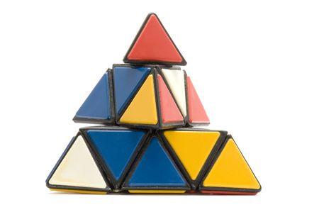 conundrum: oggetto su bianco - giocattolo enigma pyramidion  Archivio Fotografico