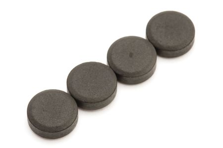 activated: object on white medical tool activated charcoal Stock Photo