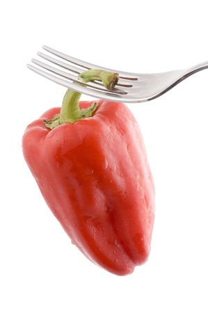 object on white - food Red pepper on fork photo
