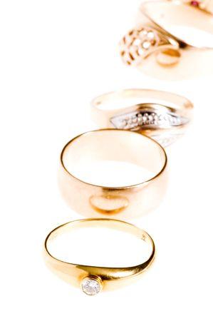 object on white - Golden rings macro photo