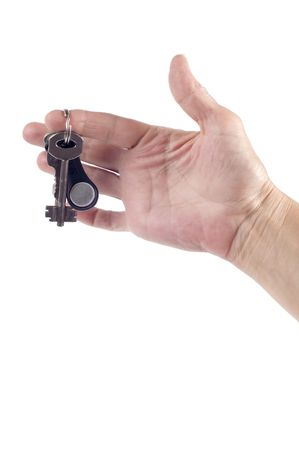 object on white - Key on hand Stock Photo - 3550262