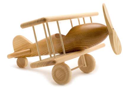 juguetes de madera: objeto en blanco - avi�n de juguete de madera Foto de archivo