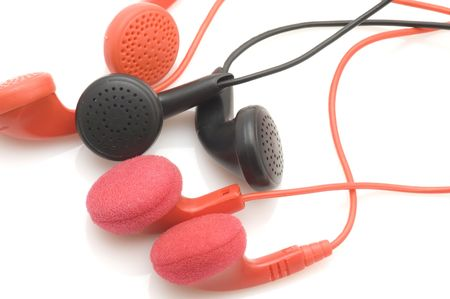handsfree telephones: object on white - tool Colored ear phones