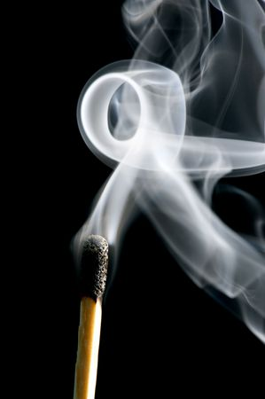 consumable: object on black - match with smoke Stock Photo