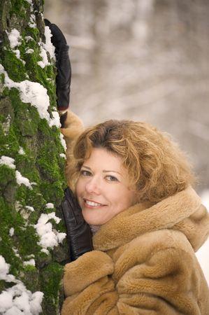 womanhood: winter park - portrait woman in the fur coat Stock Photo