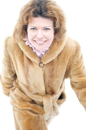 womanhood: portrait on white - woman in the fur coat