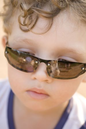 portrait - young Boy in sun glasses photo