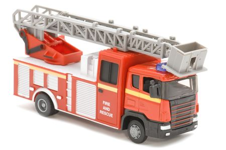 object on white - toy fire fighting vehicle photo