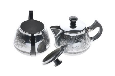 coining: object on white - kitchen utensil metal teapot Stock Photo