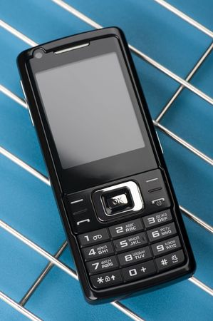 object on blue - mobile phone close up Stock Photo