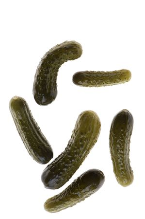 object on white - food cucumber in marinade photo