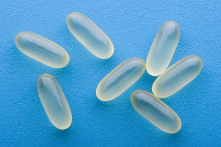 object on blue - Medical Tablets close up Stock Photo - 6252465