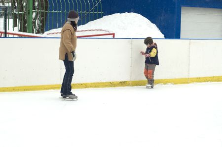 winter - Mum learn to skate a Boy photo