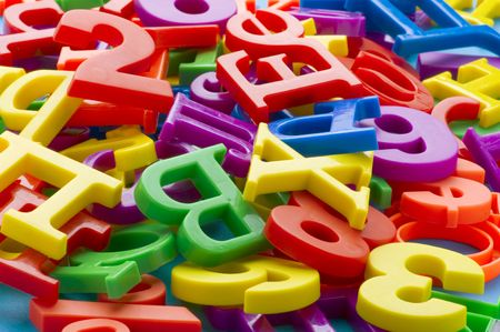 object on blue - toy plastic letters and numbers Stock Photo - 6650005