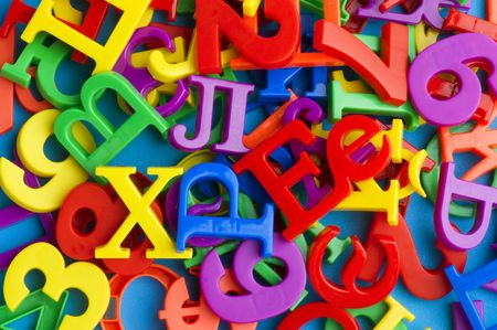 object on blue - toy plastic letters and numbers photo