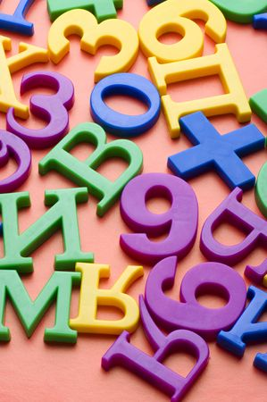 object on red - toy plastic letters and numbers Stock Photo - 6650007