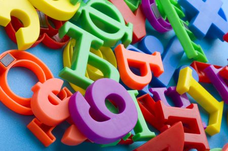 object on blue - toy plastic letters and numbers Stock Photo - 6650011