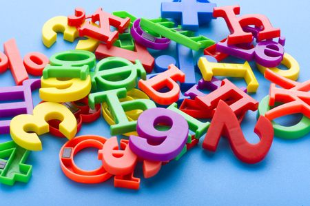 object on blue - toy plastic letters and numbers Stock Photo - 6650008