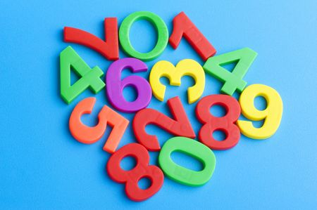object on blue - toy plastic mathematical character Stock Photo - 6650014