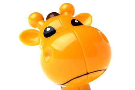 object on white - toy giraffe close up photo