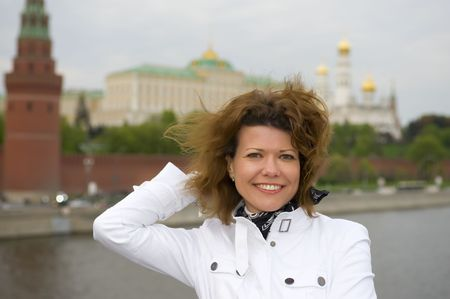 portrait Russian people - woman and Moscow kremlin photo