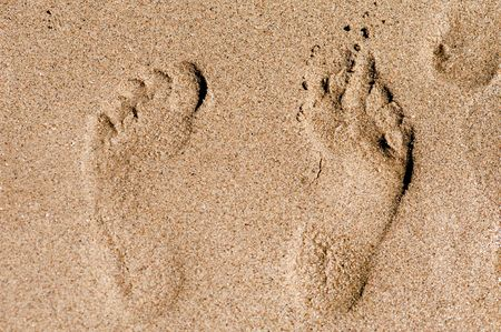 outdoor- footprint in the sand close up photo