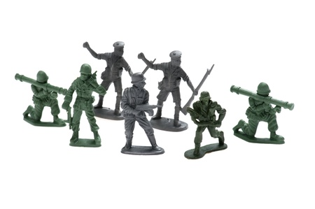 object on white - plastic toy soldiers close up photo