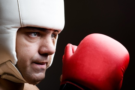 boxer in protective helmet and boxing gloves photo