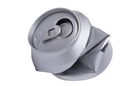 object on white - Crumpled beverage can photo