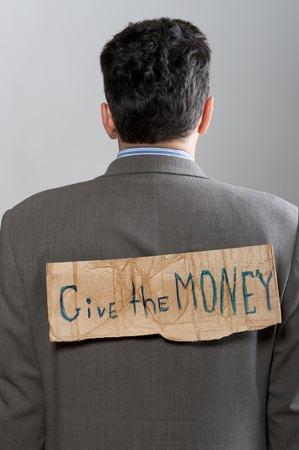 man with cardboard sign Give the money on grey photo