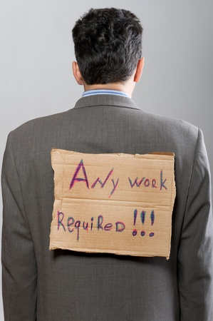man with cardboard sign Any work on grey photo