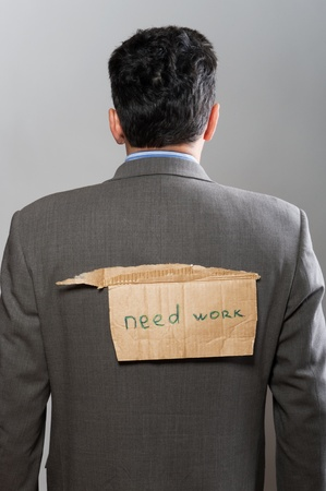 man with cardboard sign Need Work on grey photo