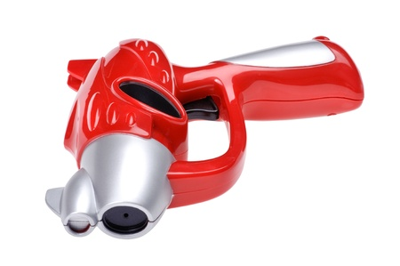 object on white - toy gun close up photo