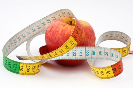 it is a red apple with the tape to measure photo