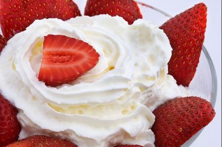 a red strawberry on white cream photo